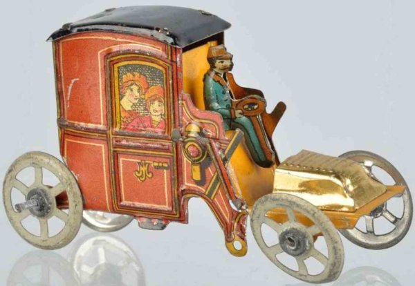 Meier Tin-Penny Toy Automobile made of lithographed tin, gold wash bonnet hood.