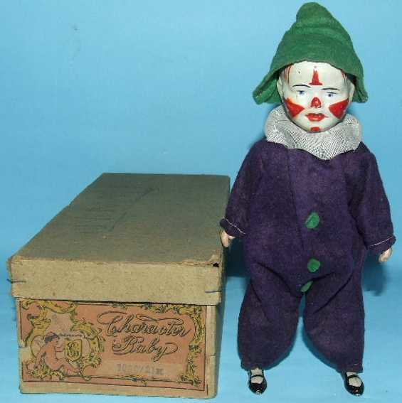 Guenthermann Tin-Automata Character baby clown #1000/2, hand-painted mechanical windup
