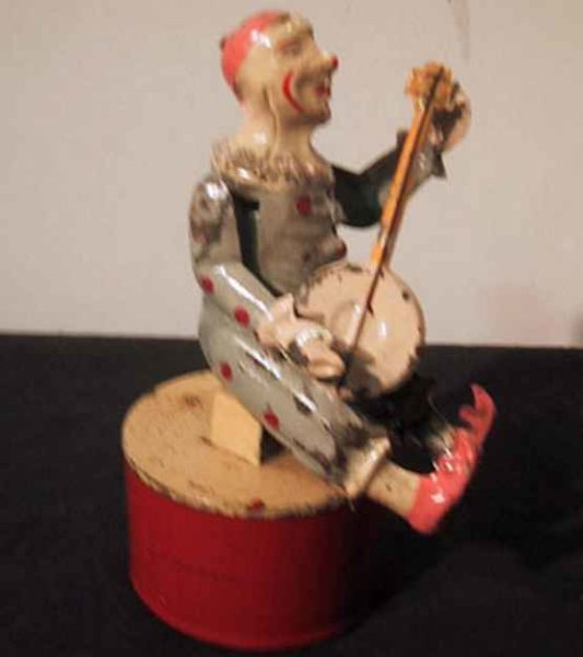 Guenthermann Tin-Clowns Clown hand-coated plays that banjo, wound you hear a plink-p
