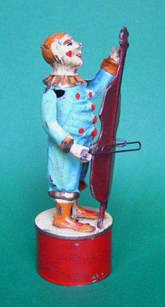 Guenthermann Tin-Clowns Clown playin Cello, wind up toy