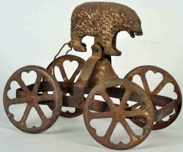 Unknown Cast-Iron Figures Cast iron bear as bell toy with tin heart-shaped wheels. Art