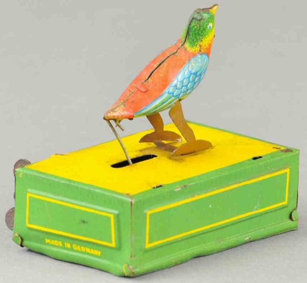 Issmayer Tin-Penny Toy Wind-up bird made of lithographed tin, depicts bird on recta