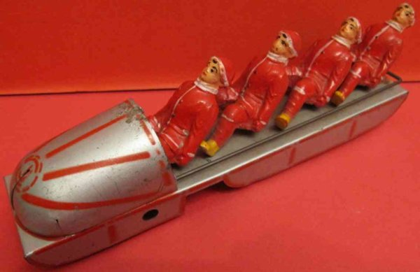 CIJ Tin-Toys Bobsled tin wind-up toy, with four composition figures