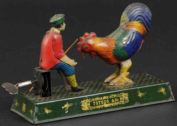 Toyodo & Co Tin-Figures Boy feeding rooster, ithographed tin, well detailed and colo