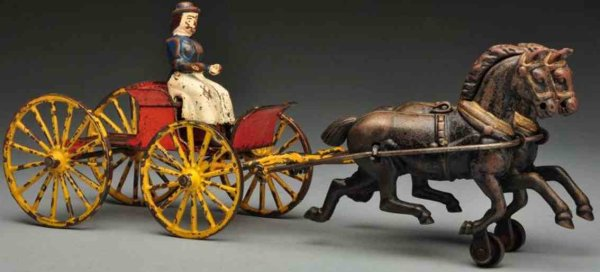 Wilkins Cast-Iron-Carriages Cast iron buckboard horse-drawn toy, all original except for