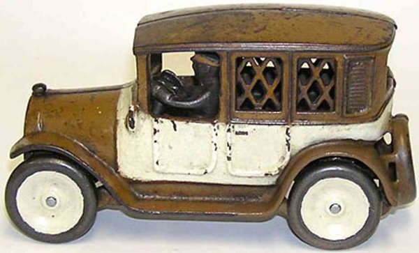Arcade Cast-Iron-Mechanical Banks Brown and white checker cab bank with cast iron driver