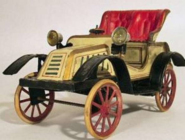 Carette Tin-Oldtimer Open car wind-up toy with driver. The front wheels are adjus