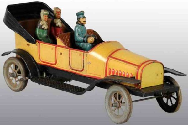 Fischer Georg Tin-Oldtimer Automobile wind-up toy includes tin litho driver and two fem