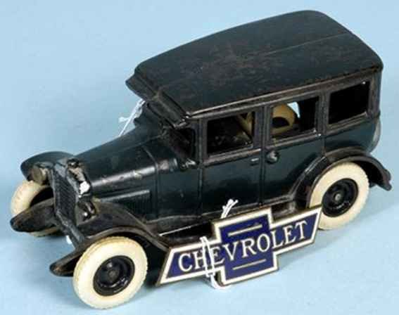 Arcade Cast-Iron Oldtimer Chevrolet Sedan,painted in blue body, black roof and running