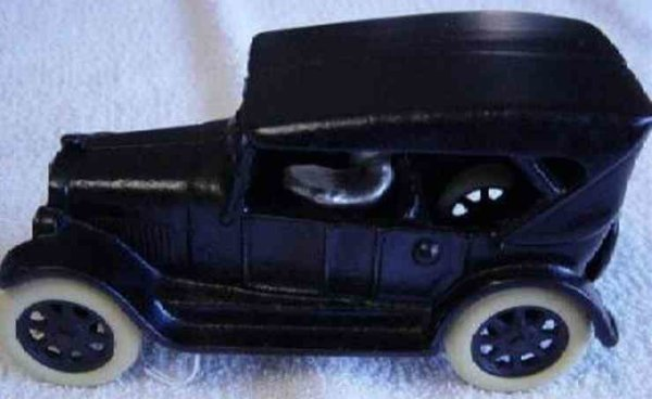 Arcade Cast-Iron Oldtimer Chevrolet Touring Sedan with driver has the bow tie on the r