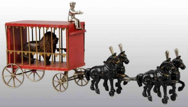 Arcade Cast-Iron-Carriages Circus cage wagon in red with lion, figure and 4 horses, of