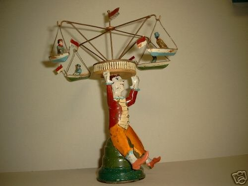 Guenthermann Tin-Carousels Ship roundabout balanced on the head of a clown. The roundab
