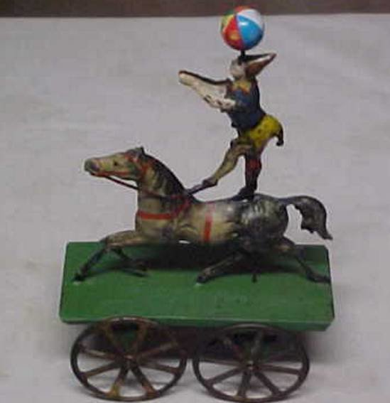Unknown Tin-Figures Clown standing on a horse riding on a wagon, wind-up toy, ha