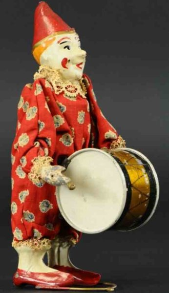 Staudt Leonhard Tin-Clowns Clown #3222 with drum and clockwork, wound up he moves head