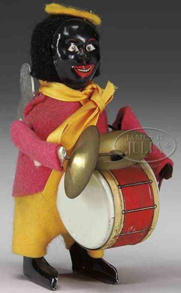 Schuco Tin-Dance Figures Black clown drummer with  lithographed tin face, felt clothi