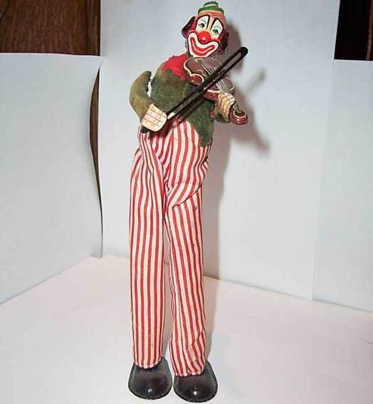 TPS Tin-Clowns Clown violinist on stilts windup toy with fixed key, wound u
