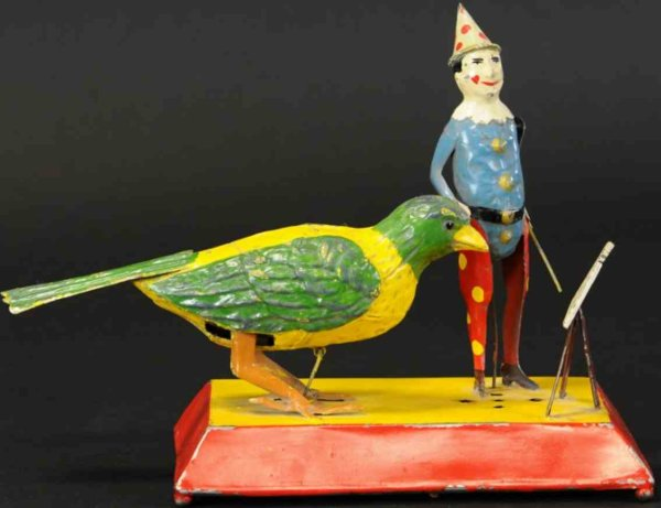Unknown Tin-Clowns Clown teaching bird a song, made in Germany, painted tin, de