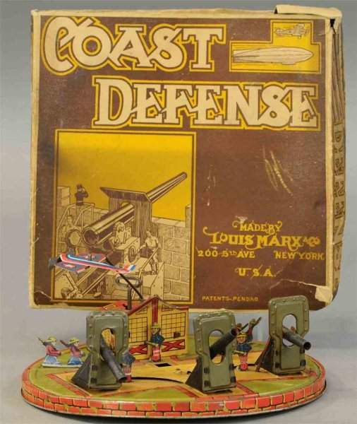Marx Tin-Toys Coast defense toy, lithographed tin, circular base, contains