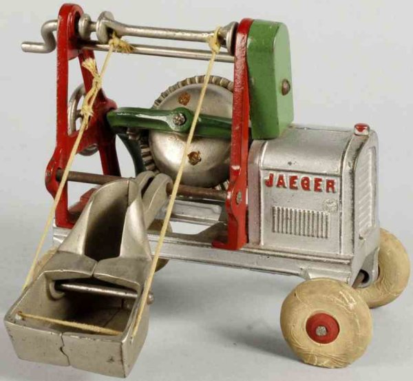 Arcade Cast-Iron Tugs-Rollers Cast iron Jaeger concrete mixer with white rubber tires and