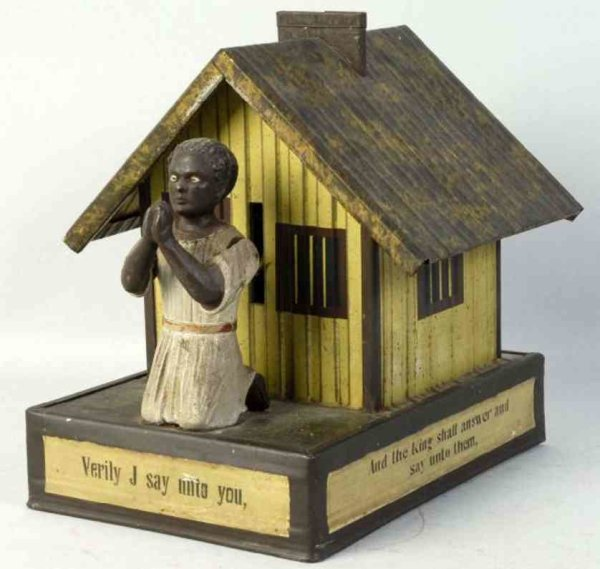 Bing Cast-Iron-Mechanical Banks Cast iron African American playing cards bank, African cotta