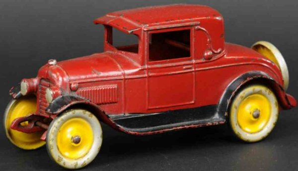 Kenton Hardware Co Cast-Iron Oldtimer Coupe made of cast  iron, done in red overall with black run