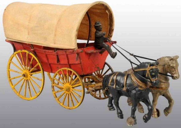 Hubley Cast-Iron-Carriages Horse drawn covered wagon pulled by a black and nickel horse