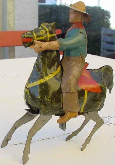 Guenthermann Tin-Figures Cowboy with horse and clockwork, wound up  the horse gallops