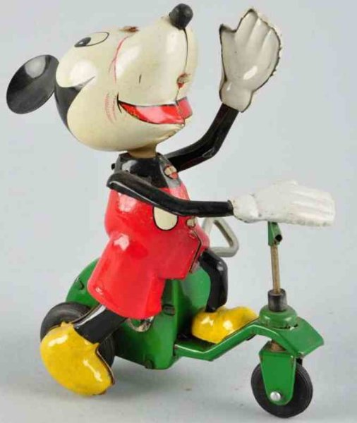 Linemar Tin-Figures Disney Mickey on scooter of lithographed tin with wind-up me