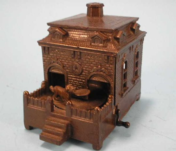 Judd H.L. Cast-Iron-Mechanical Banks Dog on turntable bank, copper bronze finish, Coin is placed