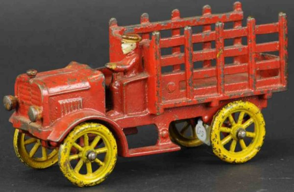 Hubley Cast-Iron trucks Open auto dray, very scarce cast iron truck, painted in red,