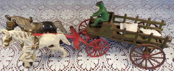 Kenton Hardware Co Cast-Iron-Carriages Two horse hitch farm wagon or dray with original paint, rubb