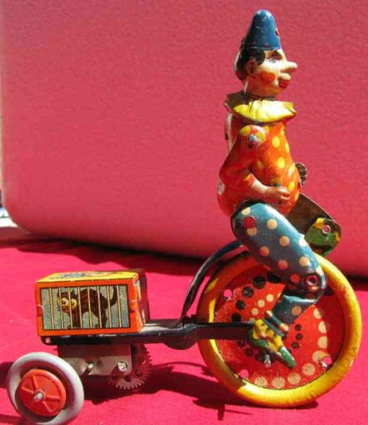 Distler Tin-Clowns Clown with tricycle and black cat, wind-up toy