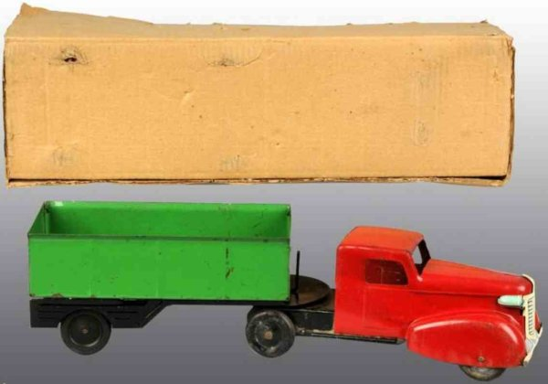 Wyandotte Tin-Trucks Dump truck of pressed steel includes original box. Two piece