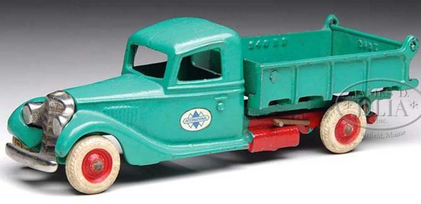 Arcade Cast-Iron trucks Cast iron International dump truck is painted green with rub