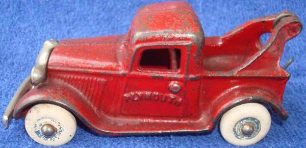 Arcade Cast-Iron trucks Plymouth wrecker cast iron toy in red with nickel plated gri
