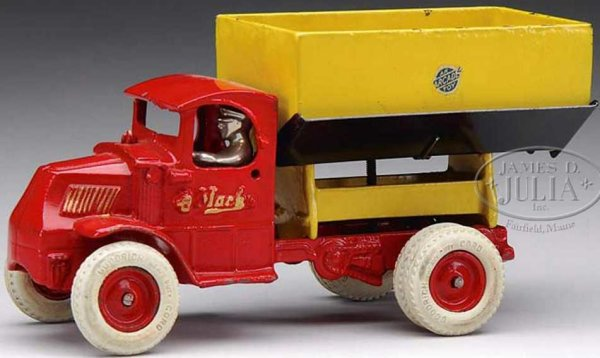 Arcade Cast-Iron trucks Cast iron Mack highbed side dump toy in red and yellow. Dual