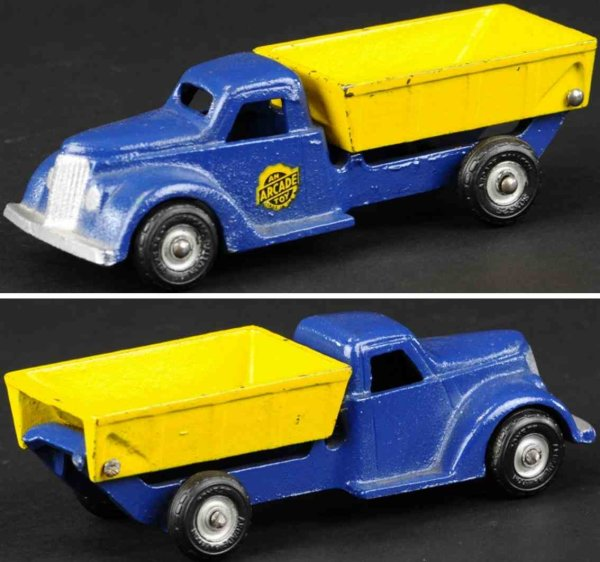 Arcade Cast-Iron trucks Dump truck made of cast iron, enclosed blue cab with yellow