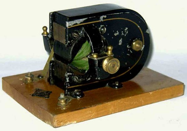 Bing Tin-Toys Dynamo generator. The lever has a green cloth cable winding.