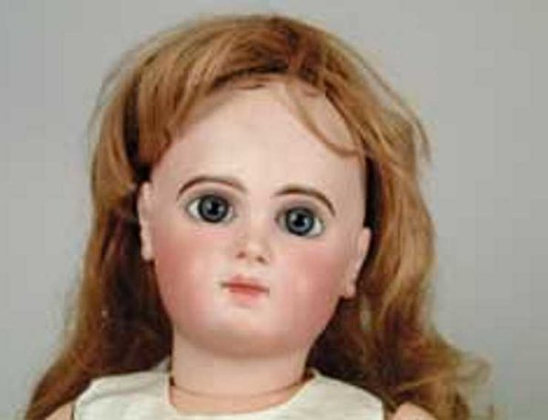 Jumeau Dolls Doll marked E12J JUMEAU, huge blue paperweight eyes on an