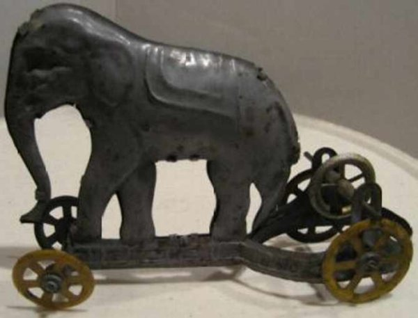 Unknown Tin-Penny Toy elephant on platform with wheels with an extra flywheel to t
