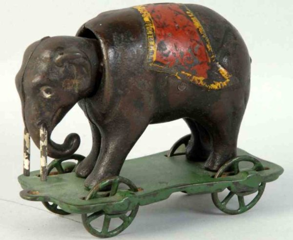 Kyser & Rex Cast-Iron-Mechanical Banks Cast iron elephant with tusks mechanical bank, the elephant