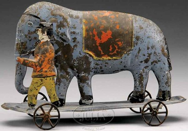 Althof Bergmann & C0 Tin-Figures Elephant pulltoy, hollow bodied elephant is being led by his