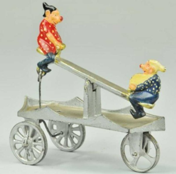Kenton Hardware Co Cast-Iron Figures Elves see-saw bell toy, a scarce toy, done in silver, base a