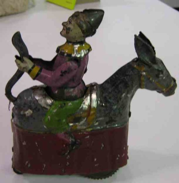 Guenthermann Tin-Clowns Clown on donkey, mechanical figure, hand-coated