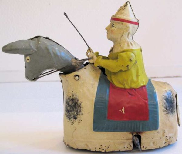 Guenthermann Tin-Clowns Clown on donkey hand-painted with clockwork, wound up the do