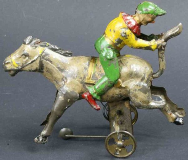 Guenthermann Tin-Clowns Clown on donkey with clockwork, clown rides upside down, fra