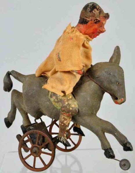 Guenthermann Tin-Clowns Clown riding donkey of lithographed tin, original clothing,