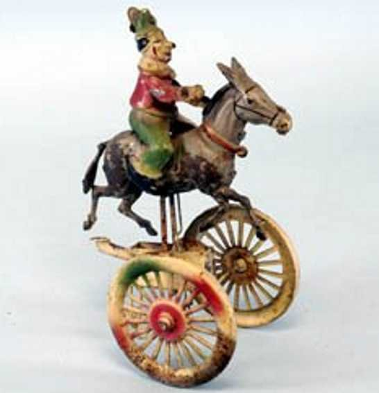 Guenthermann Tin-Clowns Clown on donkey and wheeled platform Hand-painted tin depict