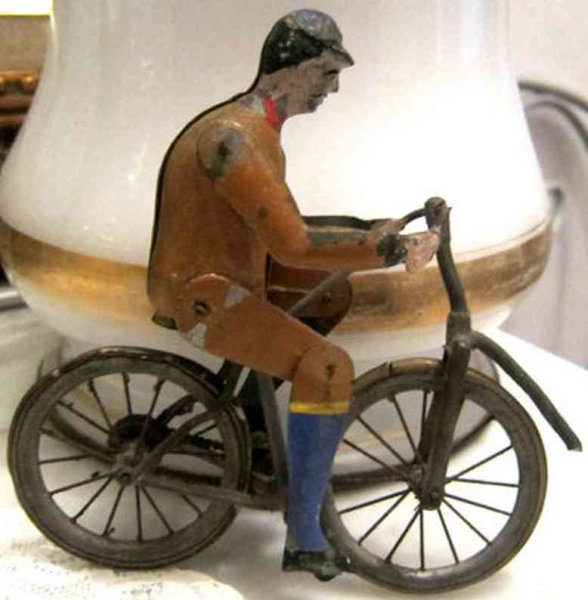 Unknown Tin-Figures Cyclist that with his legs and feet steps into the pedals so