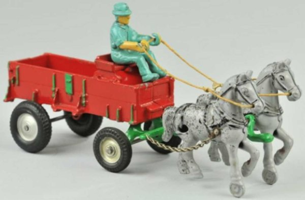 Arcade Cast-Iron-Carriages Horse drawn farm wagon of cast iron colorful red wagon with